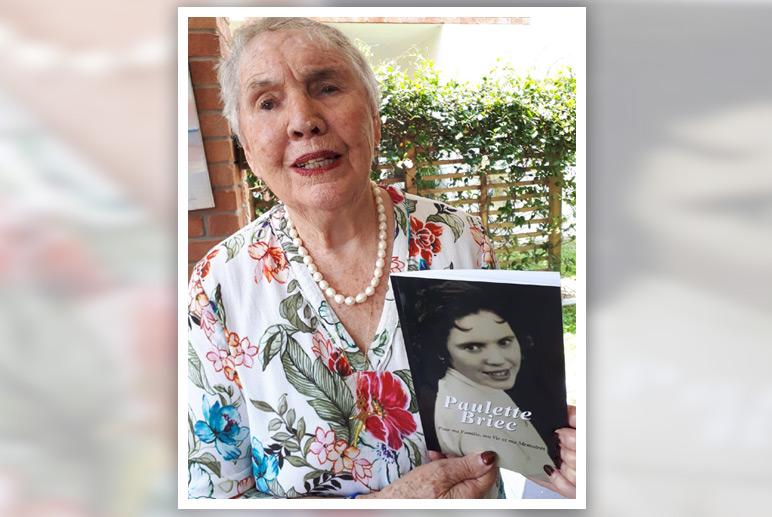 Paulette with memoir book